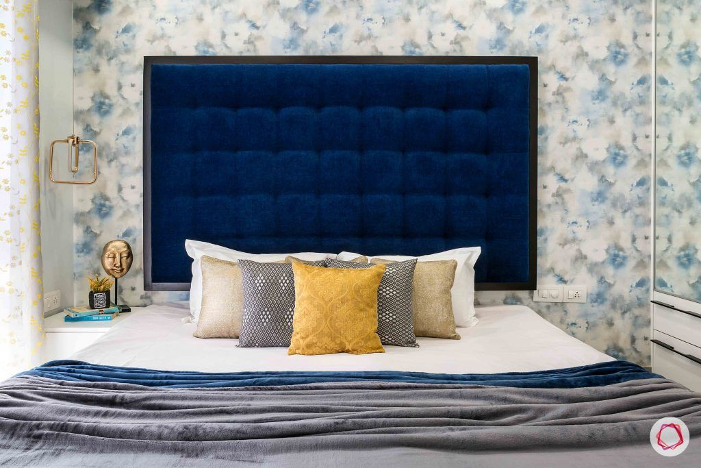 livspace interior-bedroom-headboard-blue-wallpaper-pillows
