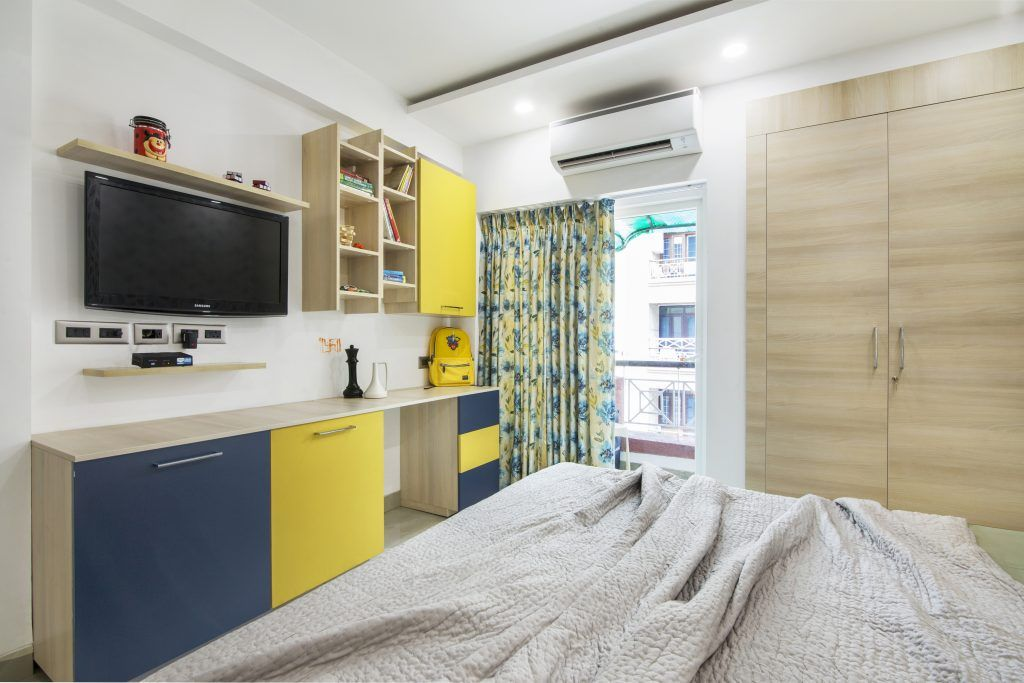 yellow-blue-brown-curtains-wardrobe-bed-balcony