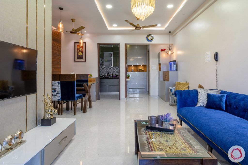 2 bhk flat interior-living room-blue sofa-wooden centre table