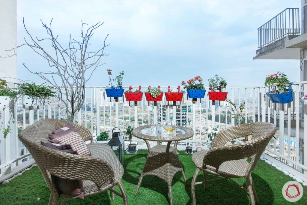 balcony-colourful planters-balcony seating-grass carpet-artificial turf