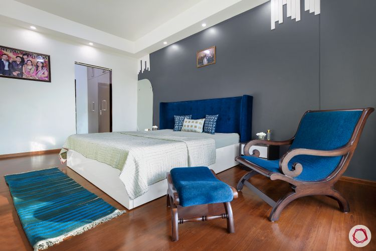 sunworld vanalika-master bedroom-grey wall-wooden flooring-blue headboard