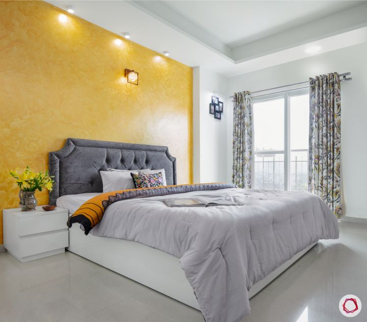 sunworld vanalika-yellow wall-texture wall paint-white bed-white bedside tables