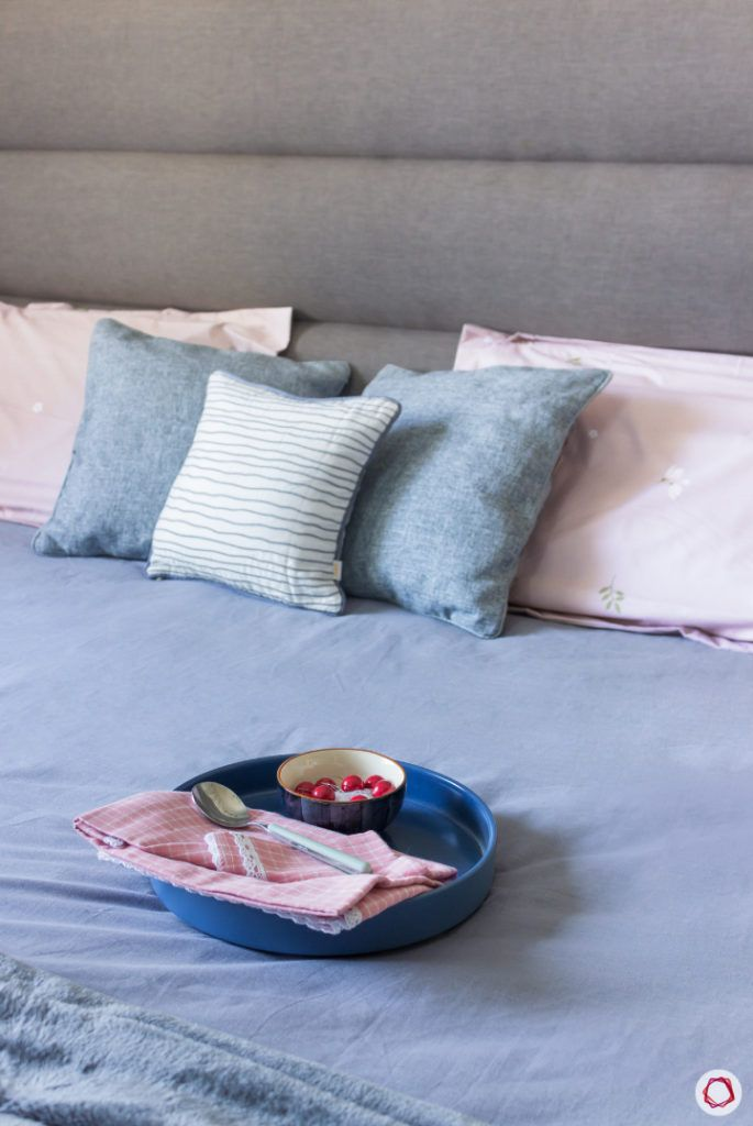top-interior-designers-in-bangalore-master-bedroom-grey-headboard-pillows