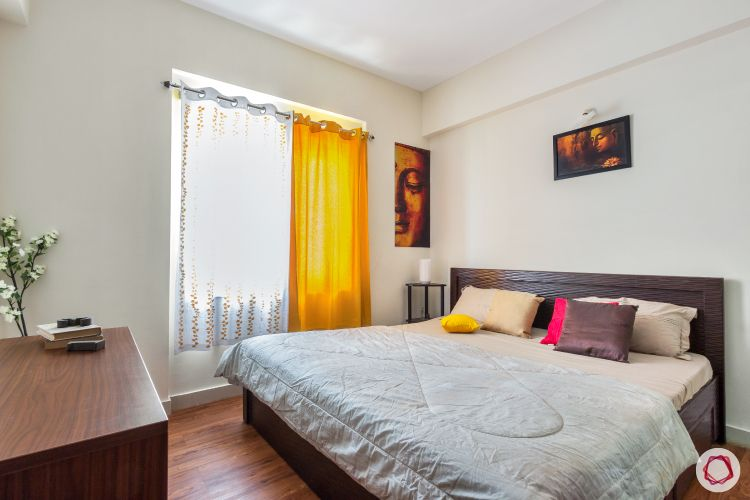 top-interior-designers-in-bangalore-wooden-bedroom-yellow-curtain