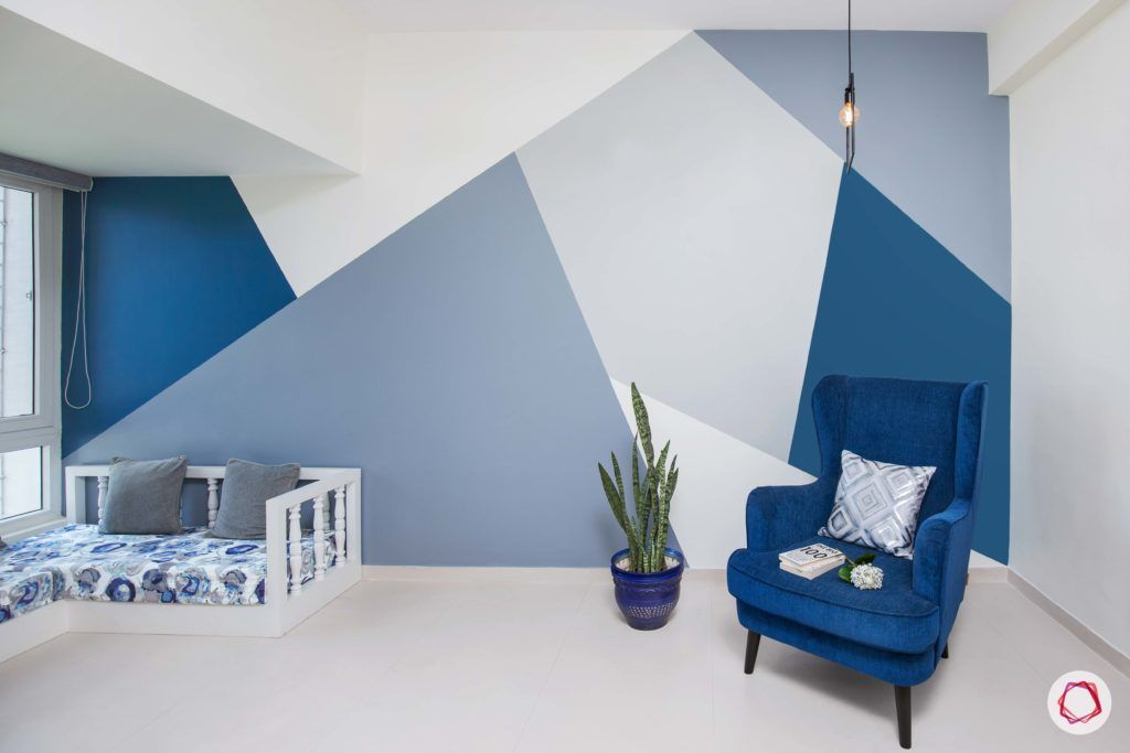 calming colors-navy blue wall paint-blue armchair designs