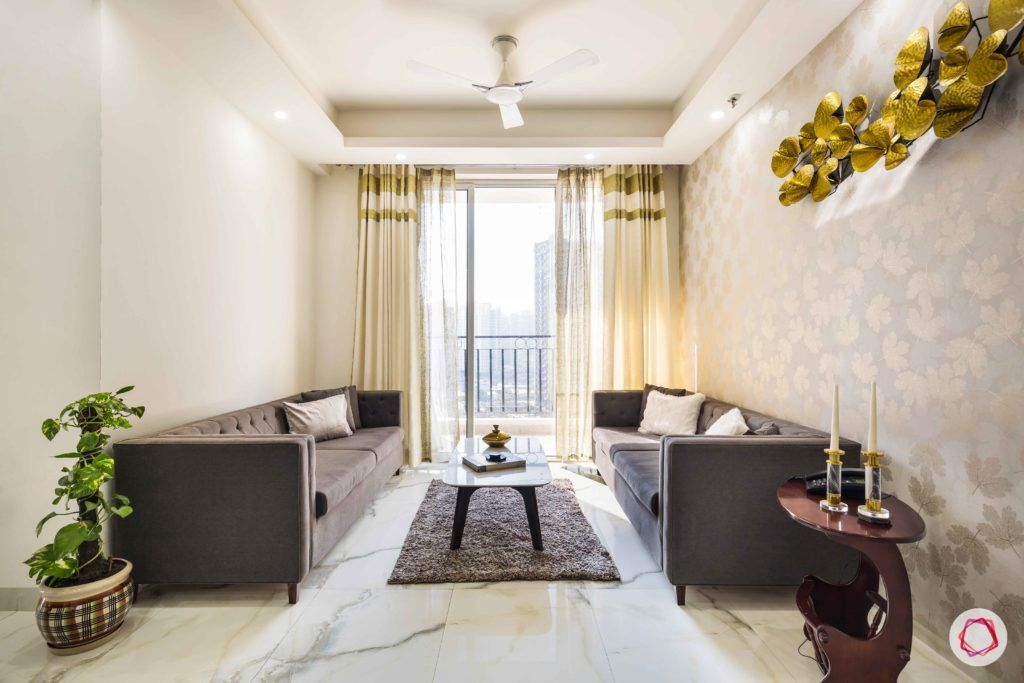 Nirala-Aspire-living-room-grey-sofas-gold-accent-coffee-table