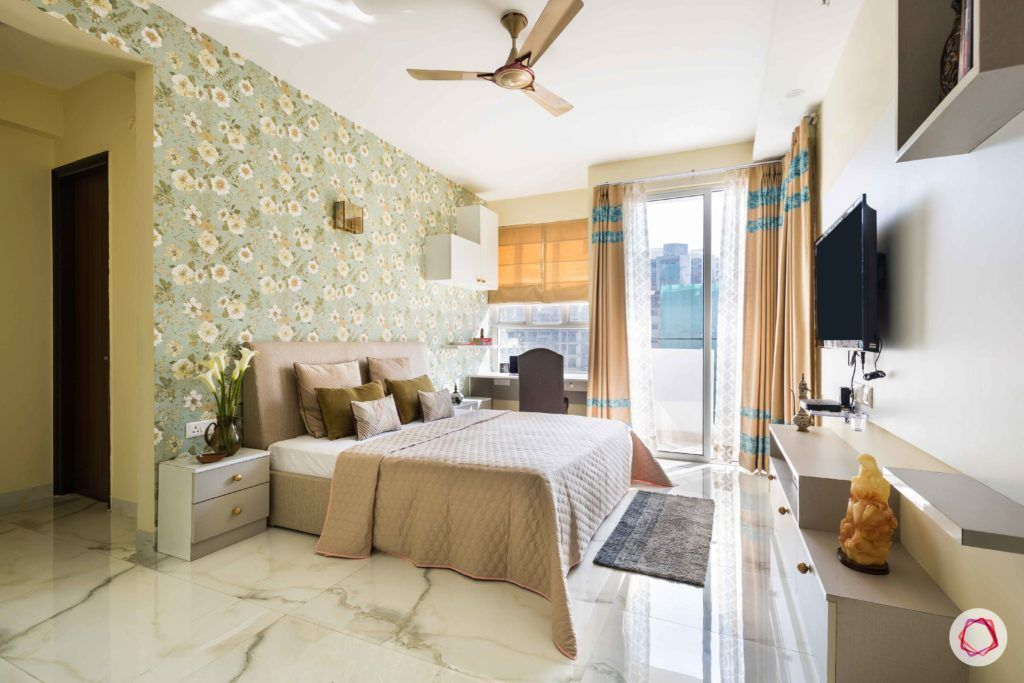 master-bedroom-floral-wallpaper-headboard-pillows-bed-curtains