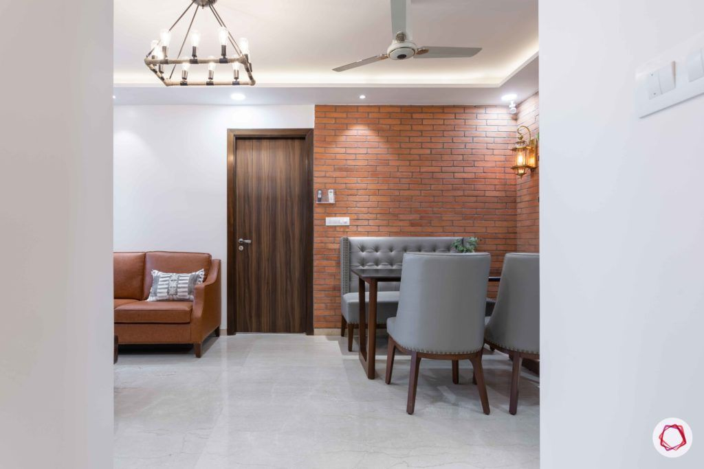 adani western-heights-exposed brick wall designs-four-seater dining set designs