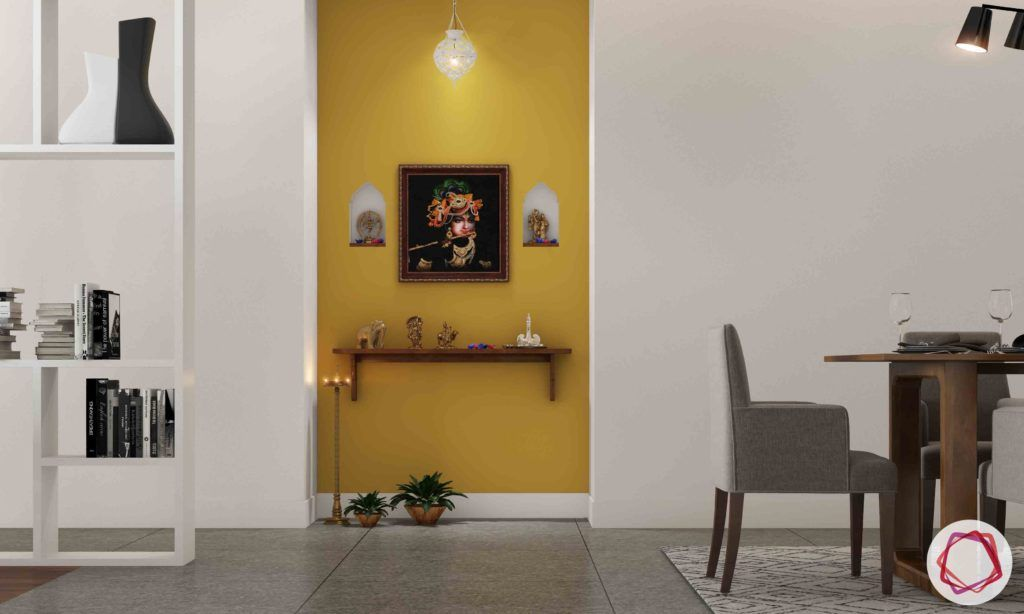 vastu colours for pooja room-yellow wall-wooden altar-lamp