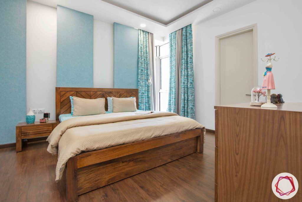 ireo victory valley-master bedroom-blue wall panels-wooden bed