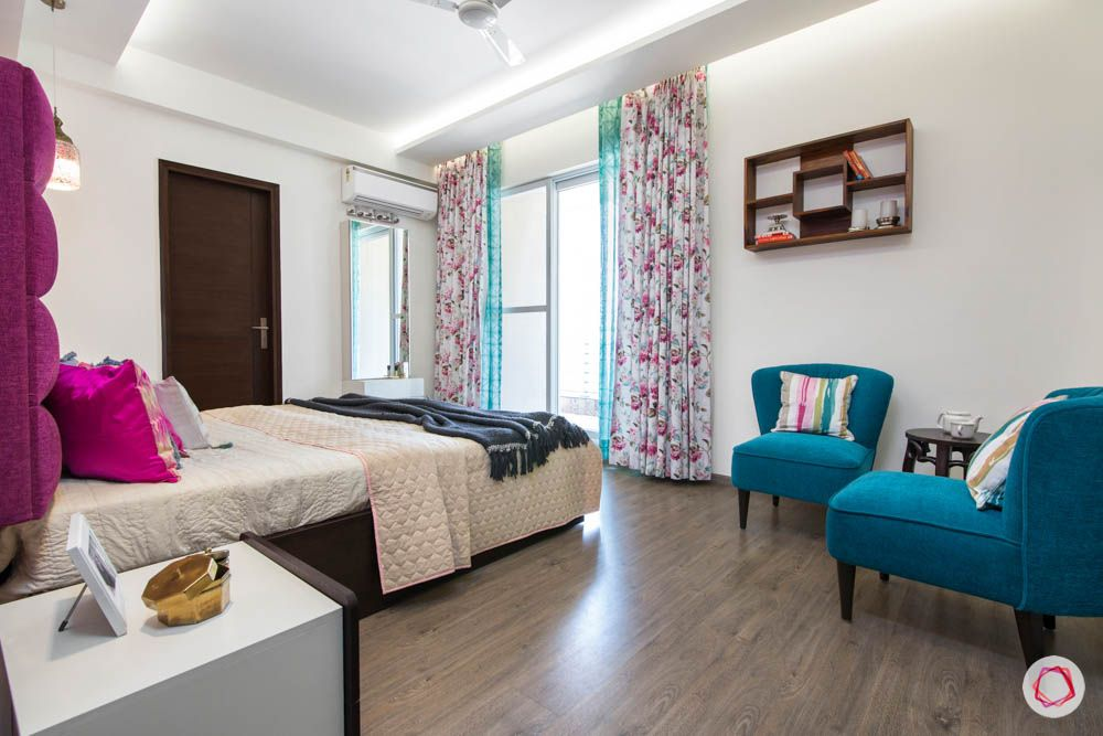 cleo county-master bedroom-wooden flooring-blue accent chairs
