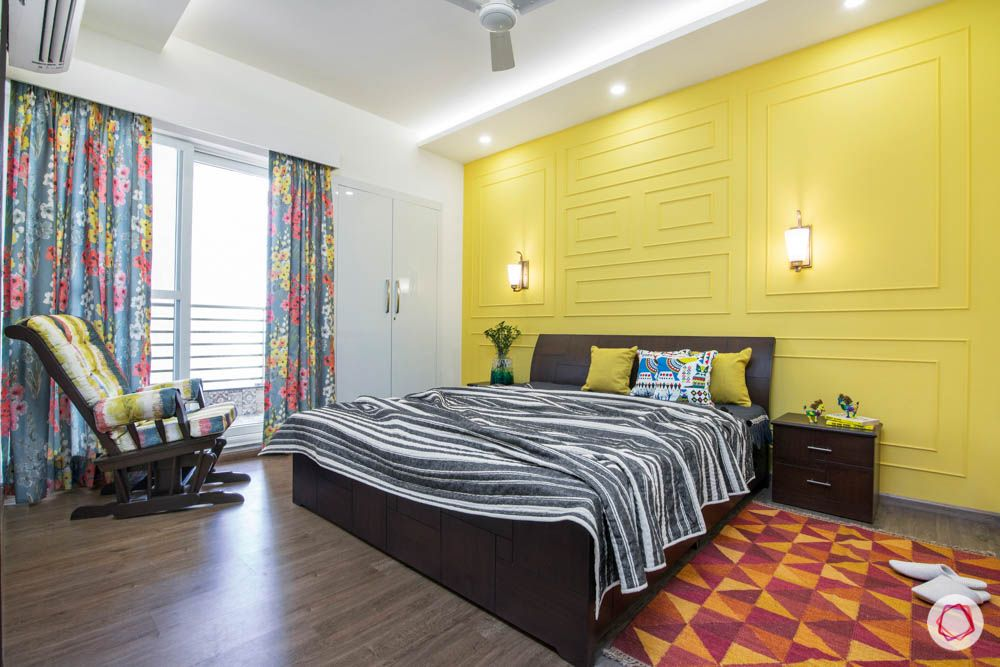 cleo county-guest bedroom-yellow wall-wall trims-area rug