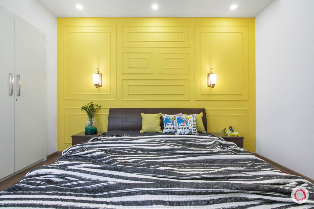 cleo county-guest bedroom-wooden bed-wall trims-wall sconces