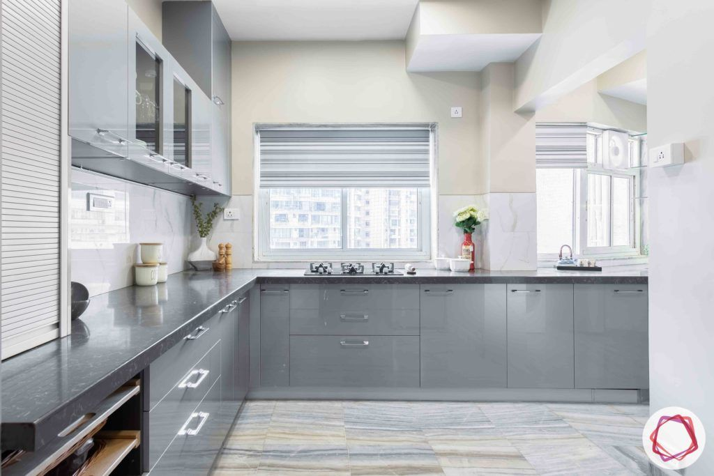 kitchen-base-grey-cabinets-window-counter-flooring-blinds