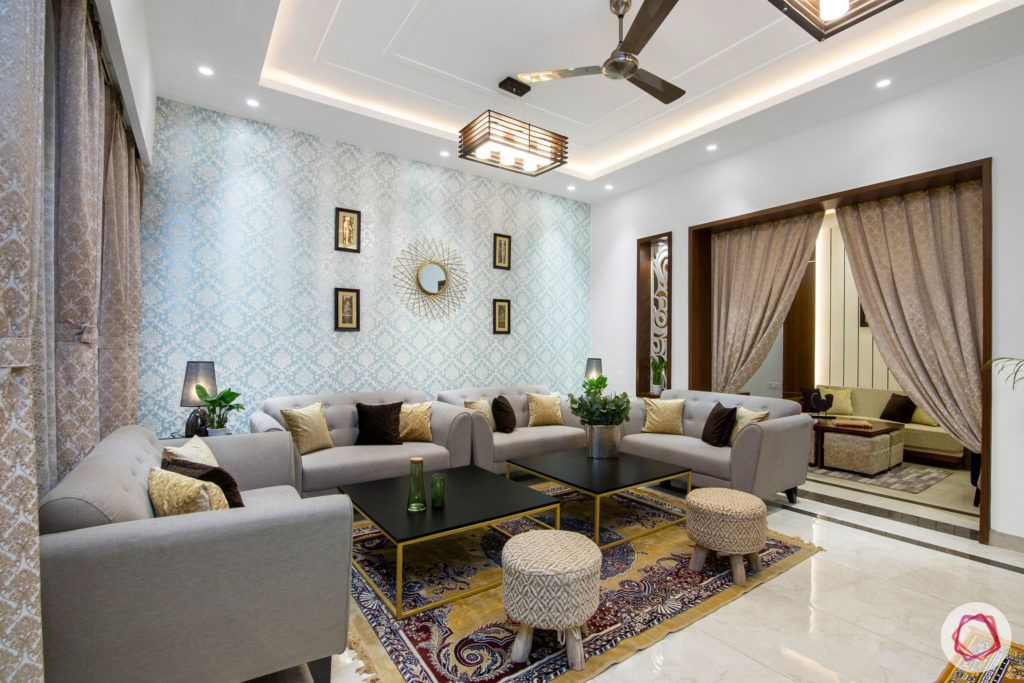 indian living room-blue wallpaper-gold wall mirror