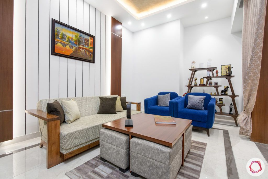 indian living room-Blue chairs-white walls-coffee table designs