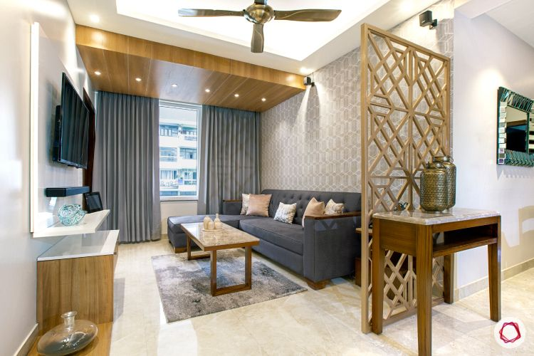 jali-design-gold-grey-sofa-false-ceiling-spotlights-coffee-table-TV
