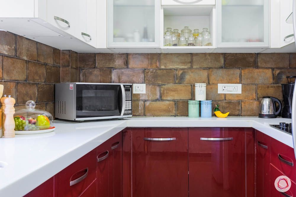 brick wall texture-red kitchen cabinets