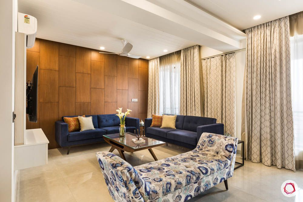 beautiful-houses-photos-living-room-sofa-blue-floral-divan-curtains-wooden-wall