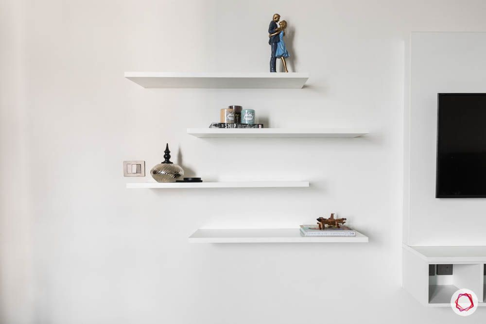 white-shelves-mounted-wall-TV-artefacts