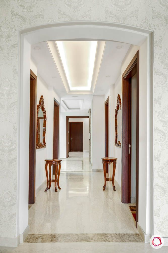 marble-flooring-false-ceiling-wood-table-mirror