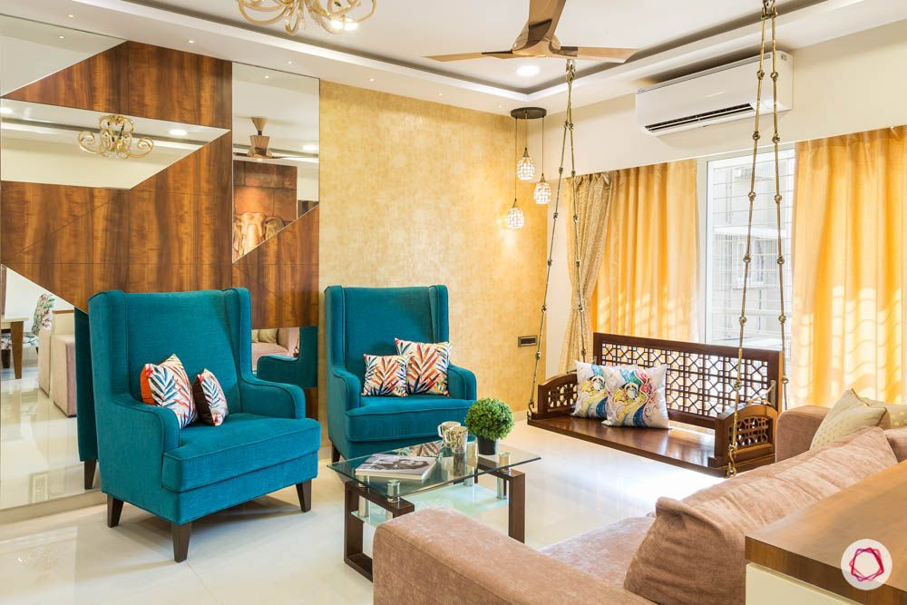 4 bhk flat in mumbai-blue accent chairs-wooden and mirror wall
