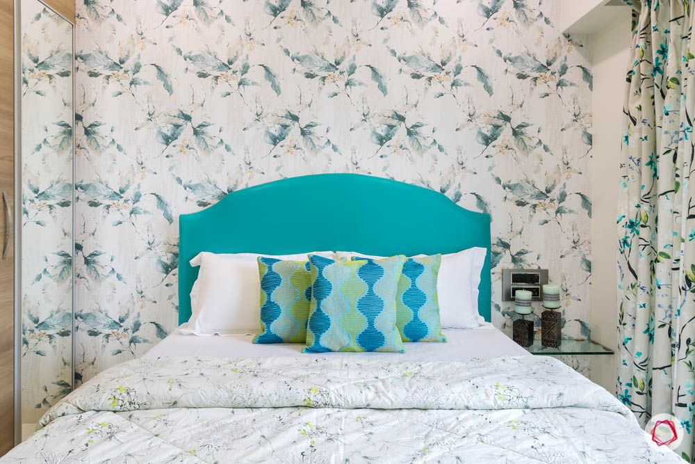4 bhk flat in mumbai-guest bedroom-bed-blue upholstered headboard-floral wallpaper