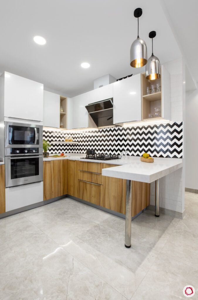 how to make a kitchen look brighter-recessed lights-white kitchen cabinets-breakfast counter