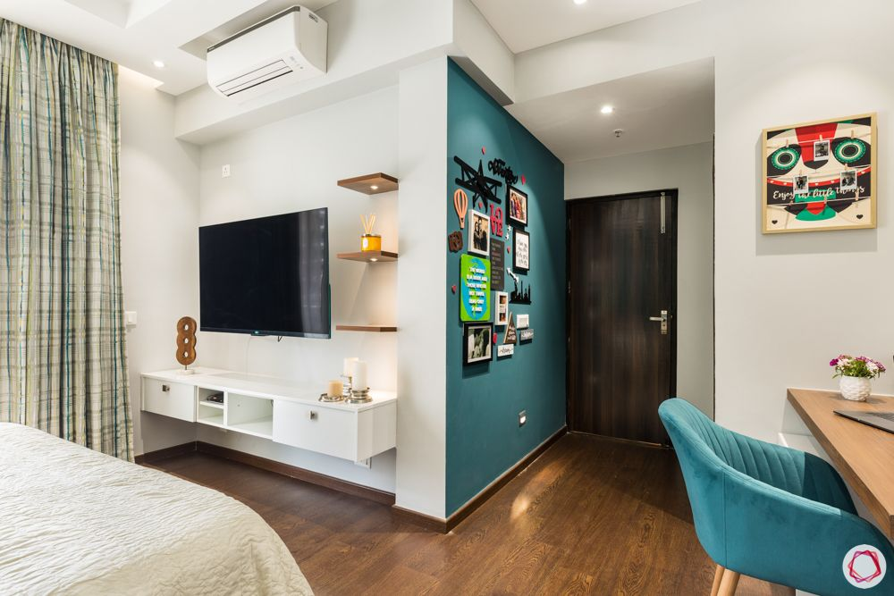 white tv unit-teal wall