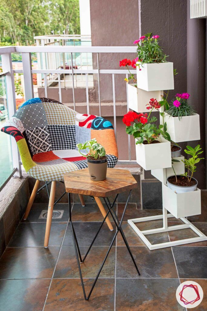 small balcony design-white vertical planter designs-colourful chair designs