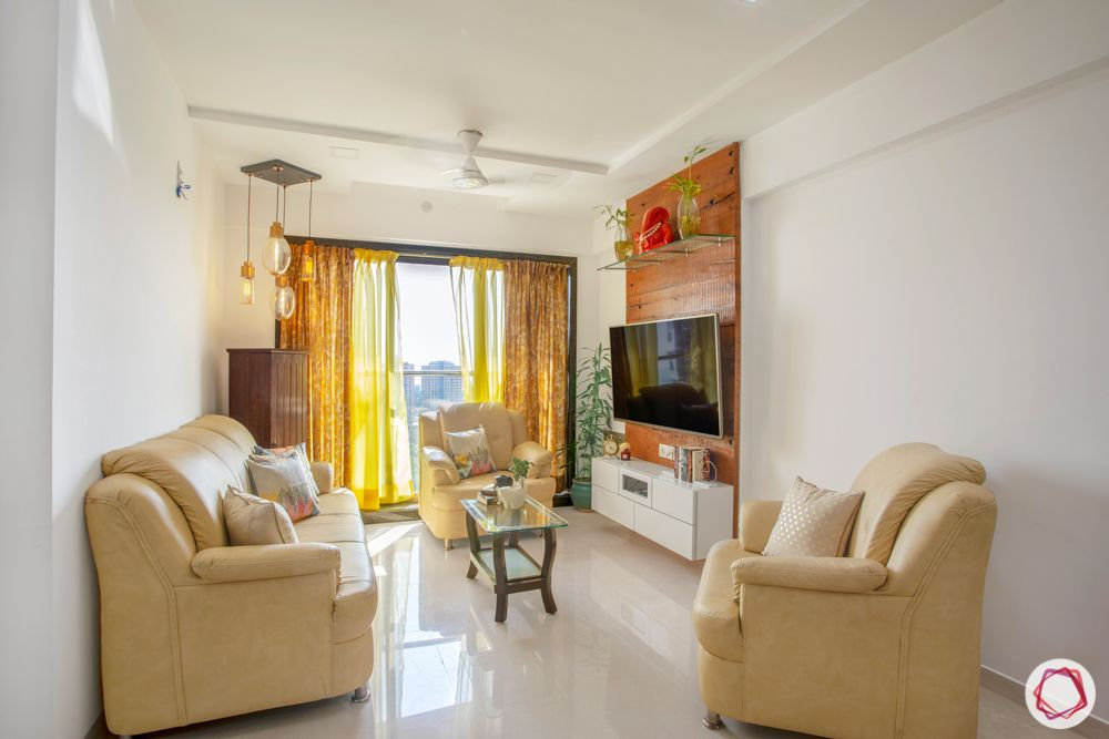 2-bhk-in-mumbai-living room-marble floor-curtains-centre table