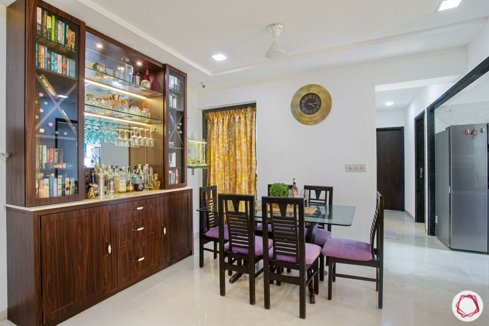 2-bhk-in-mumbai-dining room-wooden dining chairs-glass top table