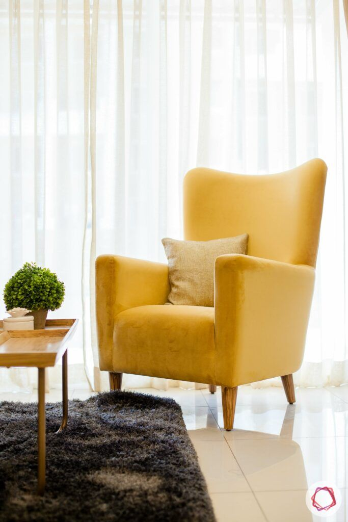 2bhk pune-yellow accent chair-indoor plant