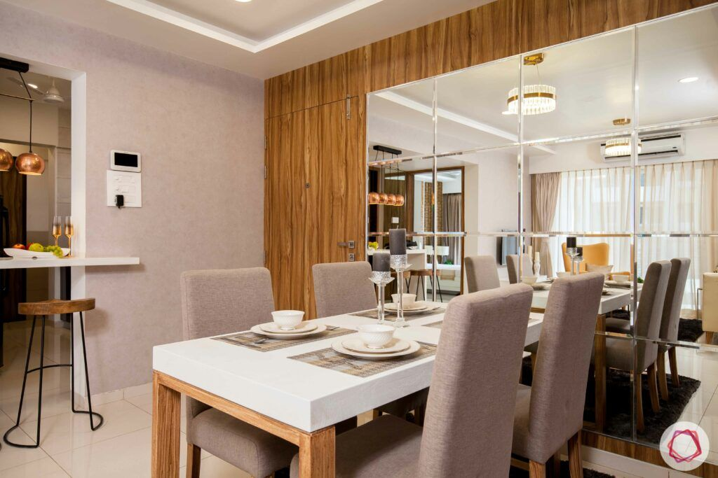2bhk pune-dining room table designs-grey chair