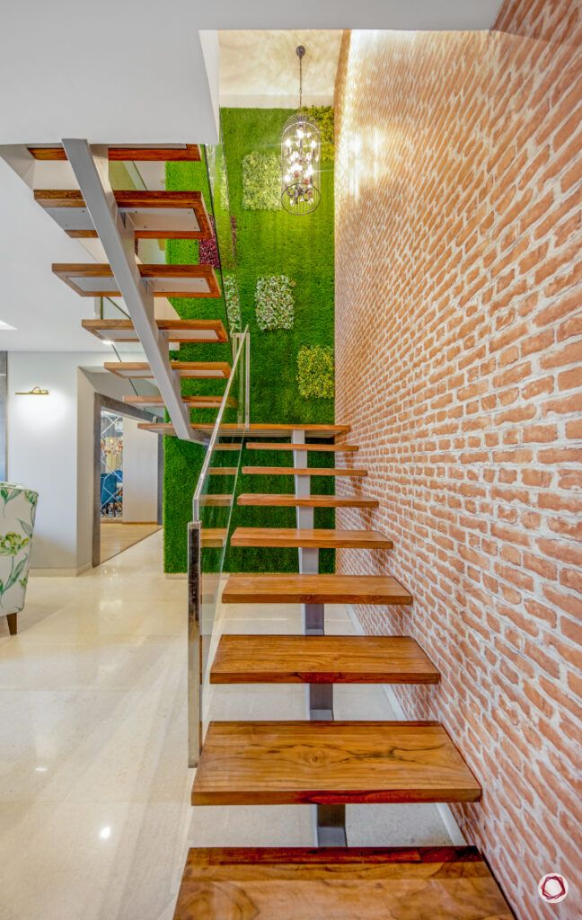 stair railing design-vertical garden-exposed brick wall-wooden steps
