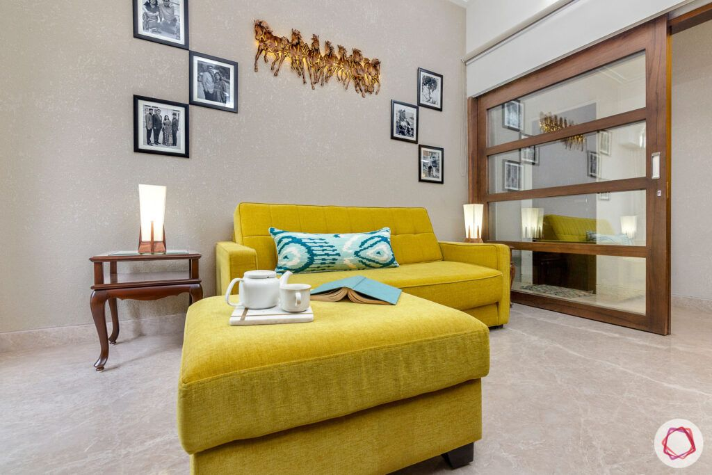 house-renovation-family-room-yellow-sofa-textured-wall