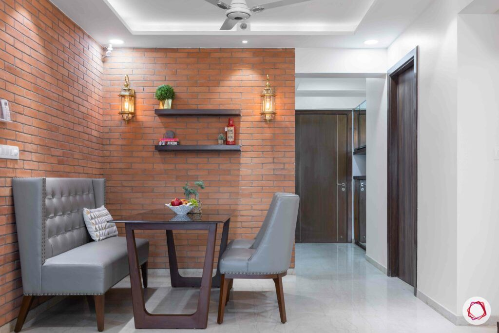wall sconces-exposed brick wall-dining room lighting