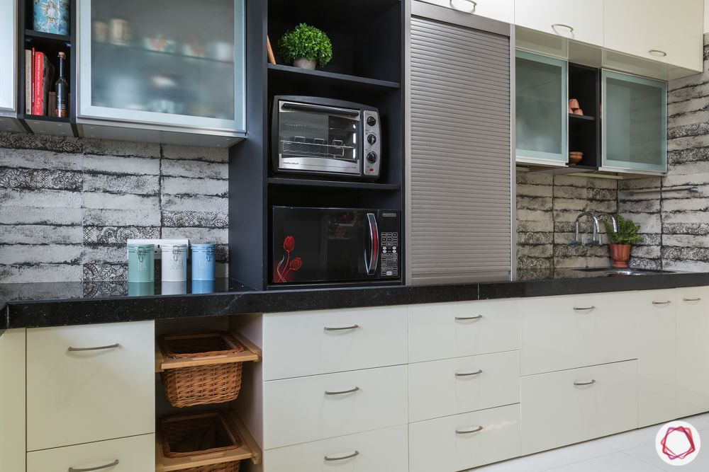 house kitchen design-open unit-tambol unit-beige backsplash-wicker baskets