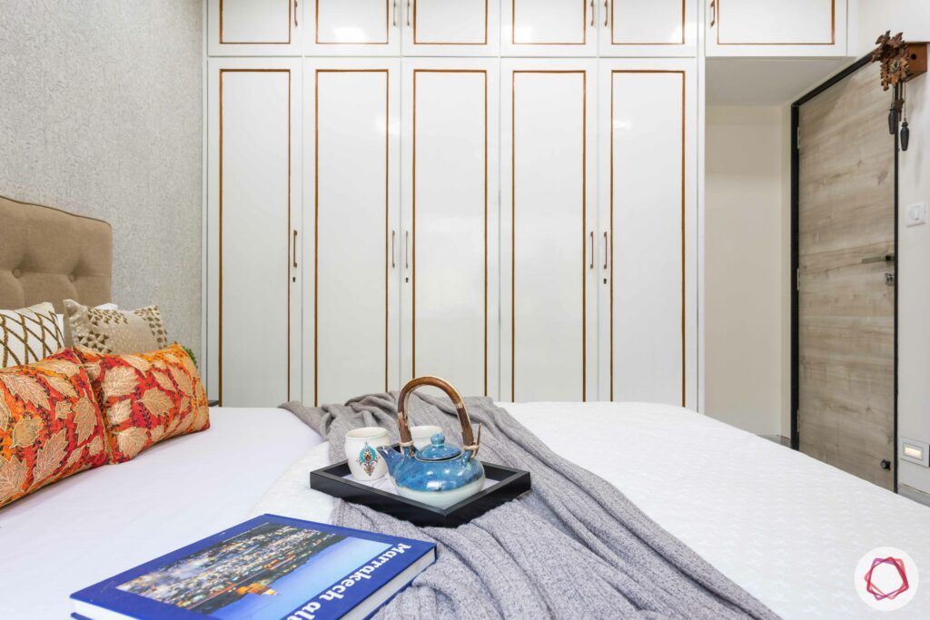 interior design company in mumbai-white wardrobe-golden groove detail