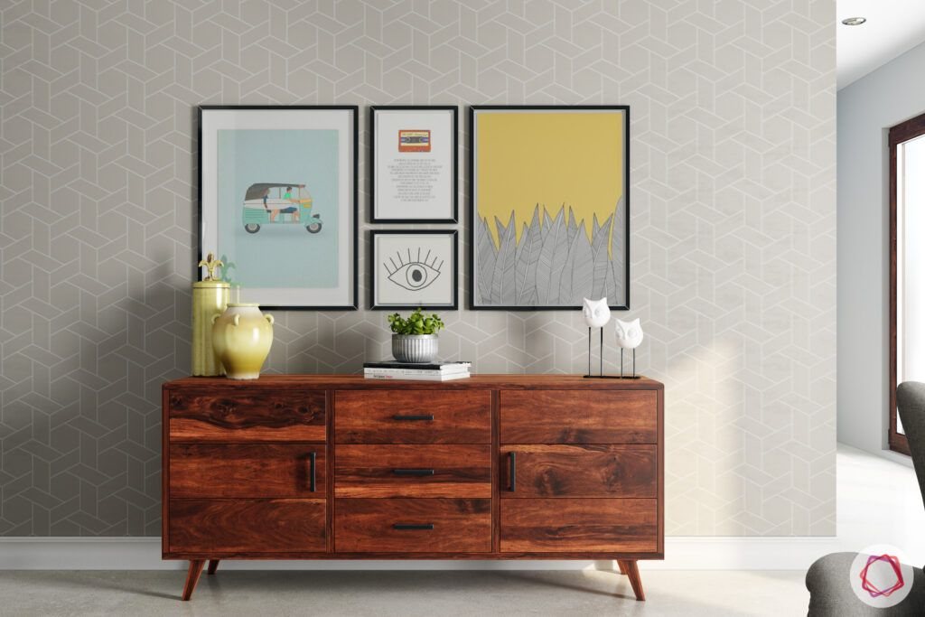 how to style a console table-wooden console-paintings-vase-grey-wall