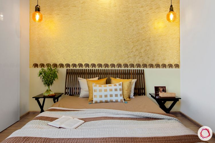 modern bedroom designs-wallpaper accent wall-yellow accent wall-wooden furniture-elephant motifs