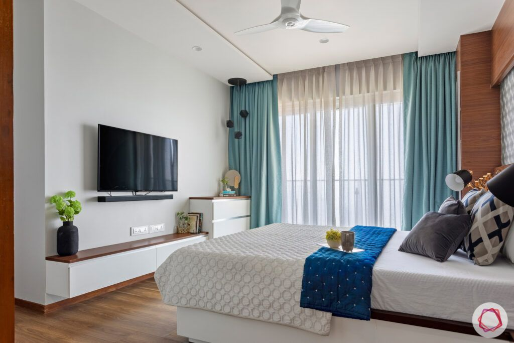 master-bedroom-TV-bed-curtains