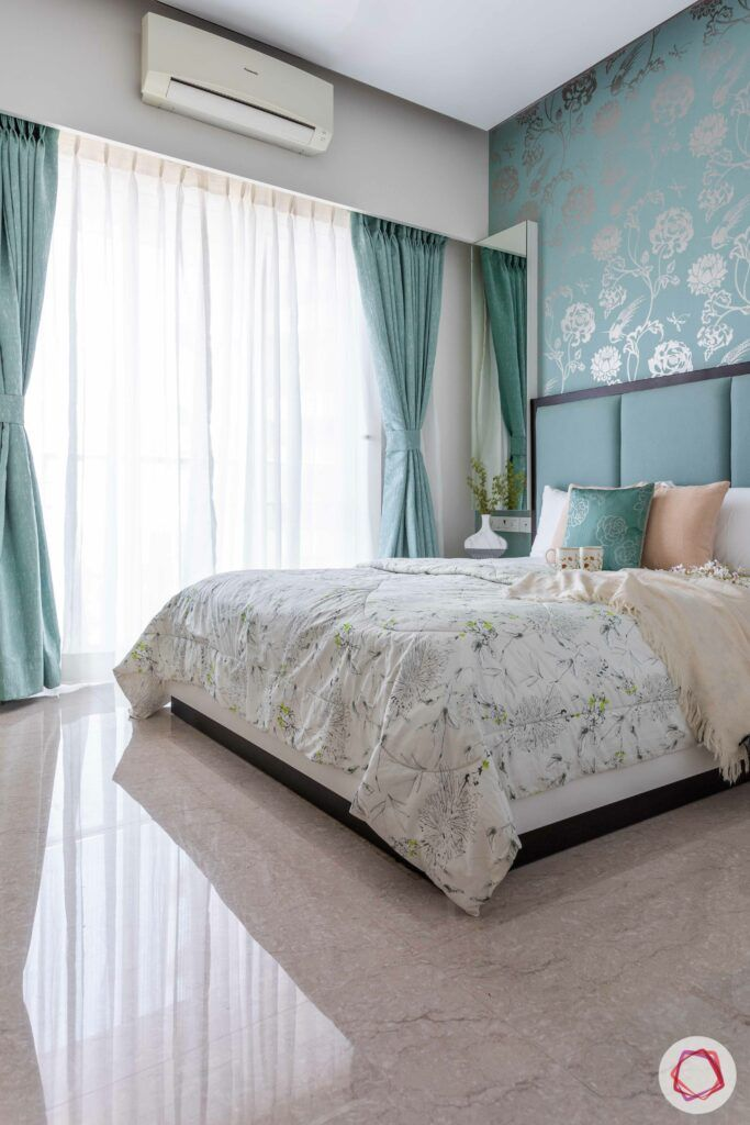 green bed-green and silver wallpaper-green curtains