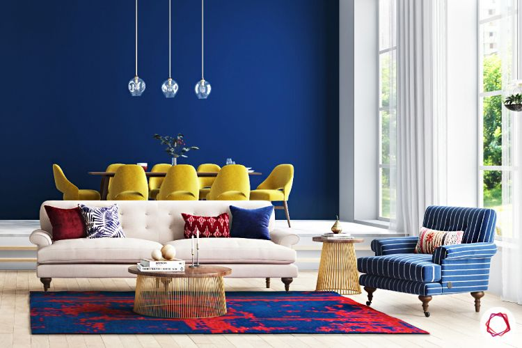 yellow chairs-blue accent chair-carpet-pendant lights