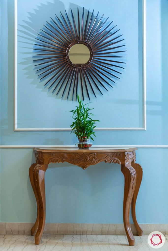 house in gurgaon-blue wall ideas-wooden console table-mirror designs
