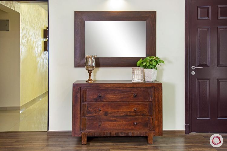 mahogany-wooden-chest-of-drawers-mirror-flooring-plant