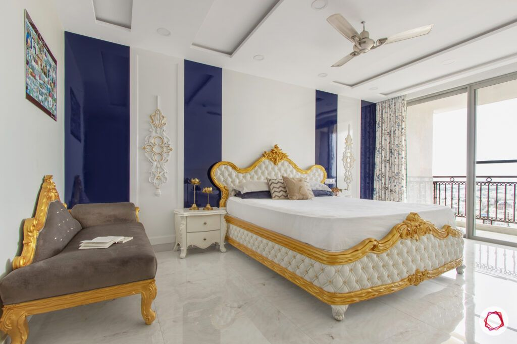 hiranandani bangalore-golden bed designs-blue and white wall accents