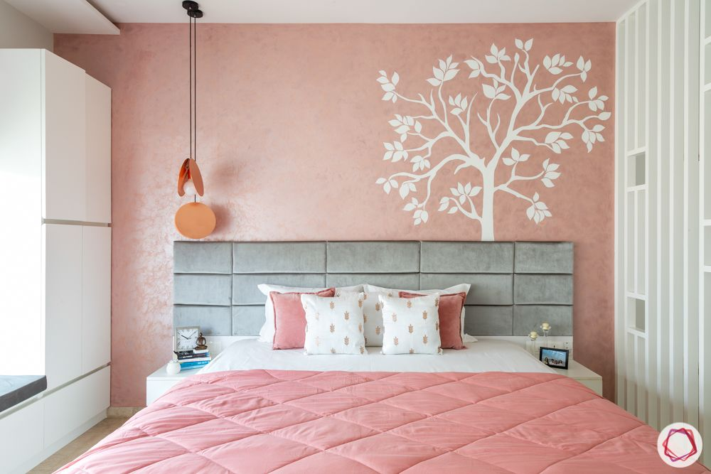 bedroom accent wall-pastel pink wall-mural painting-pendant light-grey headboard