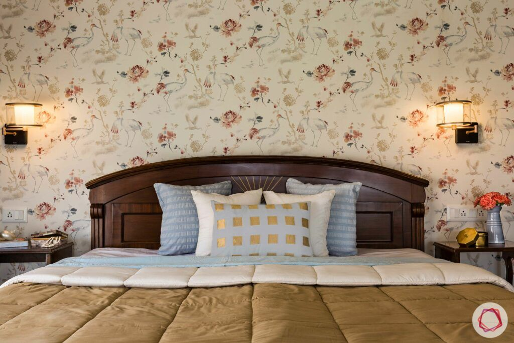 bedroom accent wall-floral wallpaper-solid wood bed-wall sconces