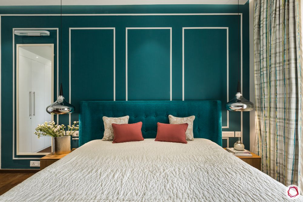 bedroom accent wall-wall trims-white wall frame designs-blue wall-blue headboard